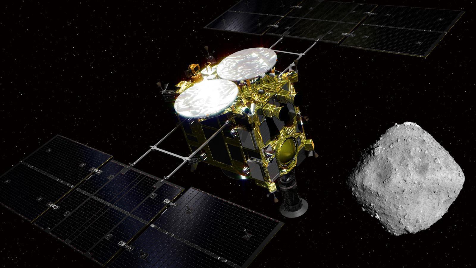 Nell'immagine: una rappresentazione pittorica della sonda Hayabusa 2 credit: Go Miyazaki / Flickr, licenza: CC BY 2.0 sovrapposta a una panoramica di Ryugu, catturata lo scorso giugno credit: JAXA, University of Tokyo and collaborators), in cui sono già ben visibili molte caratteristiche superficiali crateri, grossi macigni, ecc. dell'asteroide. L'insolita forma e la rapida rotazione del corpo celeste, completata in 7 ore e 38 minuti, lo rendono ancora più interessante per i planetologi.